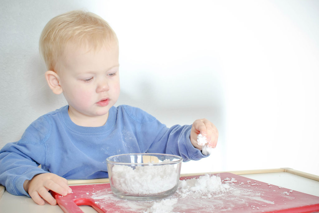 Every child I know loves homemade sensory snow. This play snow is so easy to make! Learn how to make two ingredient sensory snow on your own!