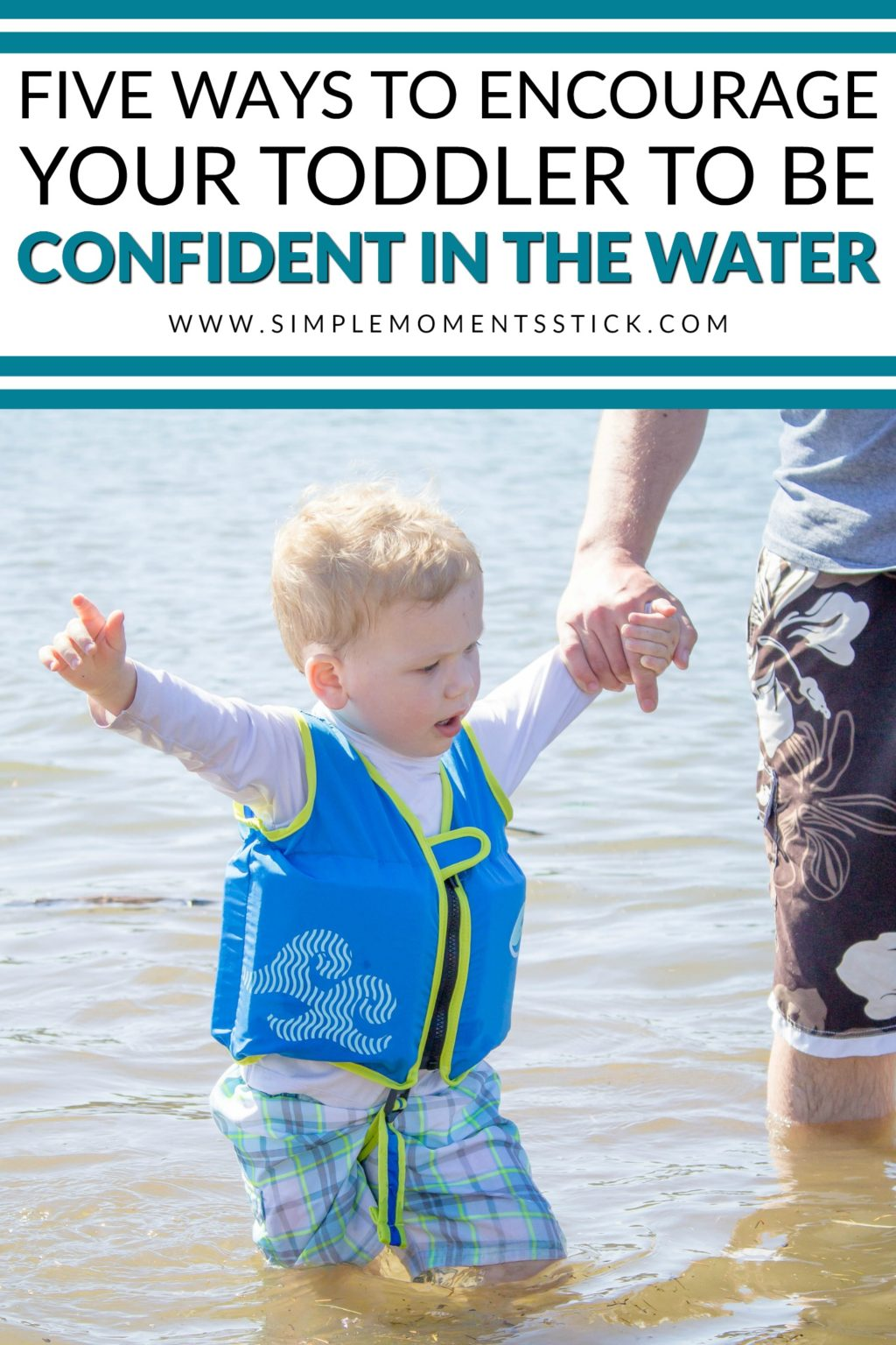 Toddler boy wearing SwimWays vest in water holding man's hand and pointing