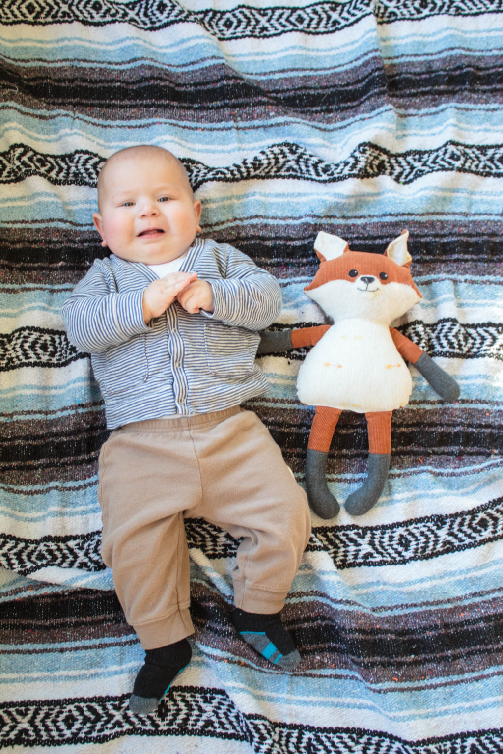 A Baby next to a stuffed animal is a perfect way to measure the baby's monthly size!