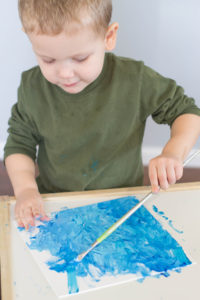 If your toddler enjoys crafting, you need to try out this wonderful process art sparkly winter snow painting! Your little one is bound to love it!